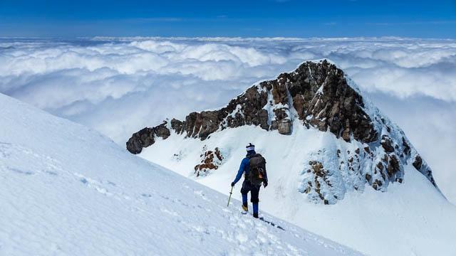 Climbing a snow capped Mount Taranaki