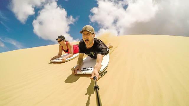 Sandboarding along 90 Mile Beach